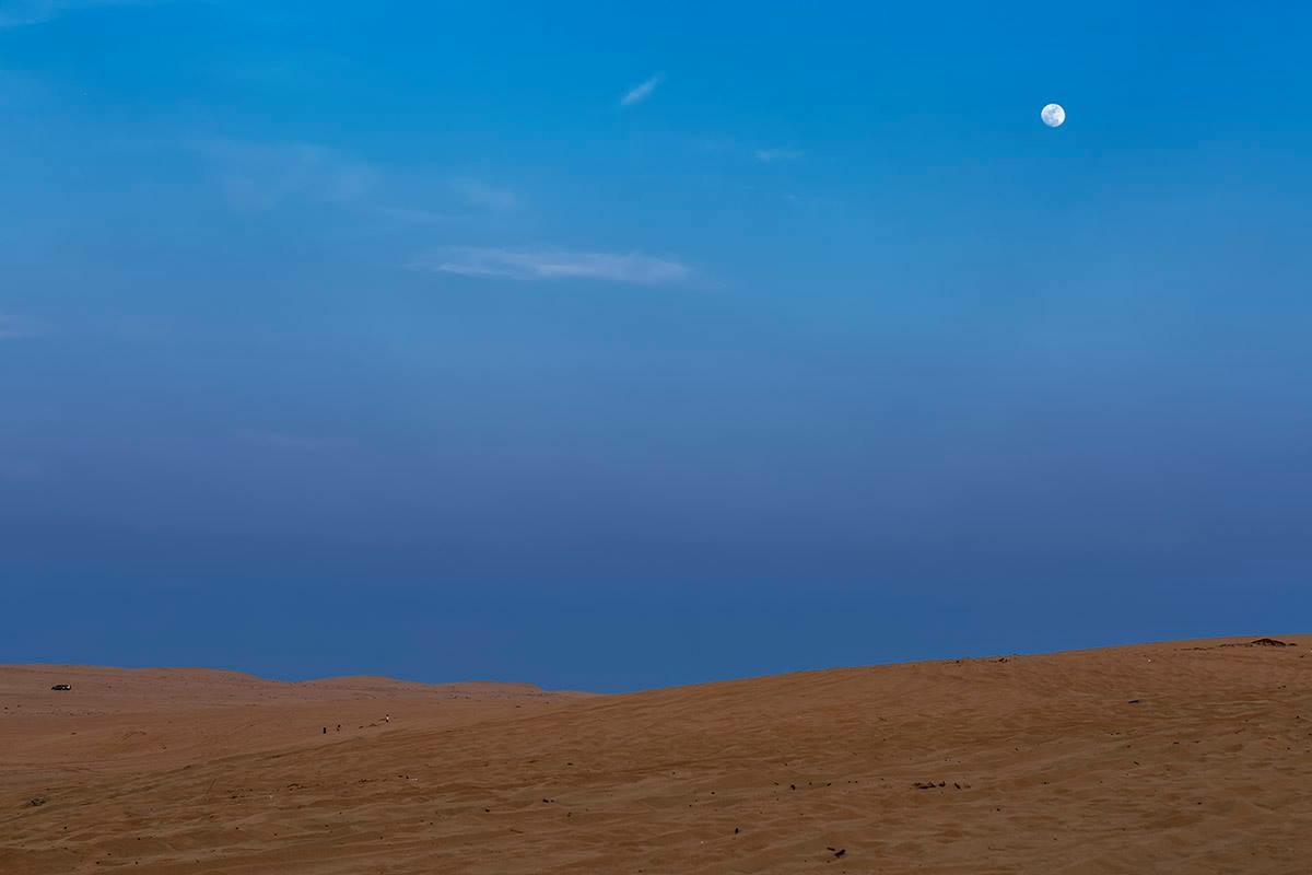 Moon in the Desert Photo by Christopher Vradis